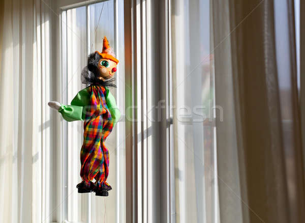 String puppet gazing outside window in sun Stock photo © backyardproductions