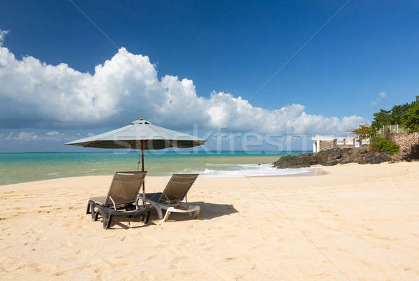 Reclining chairs and umbrella on Baie Rouge Stock photo © backyardproductions