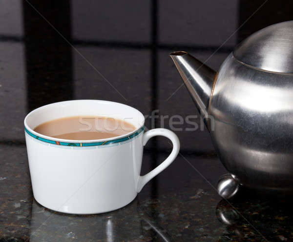 Tea poured from stainless steel teapot Stock photo © backyardproductions