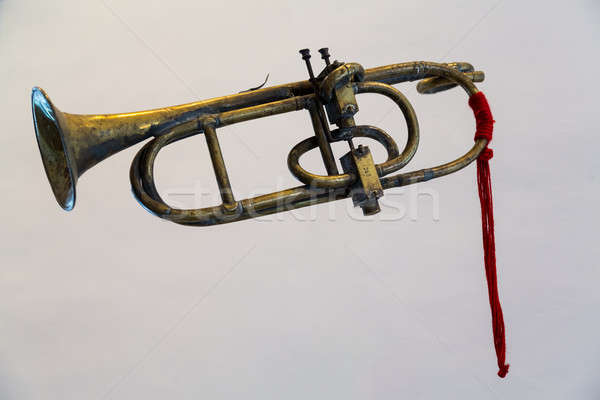 Antique bugle or trumpet isolated against grey Stock photo © backyardproductions