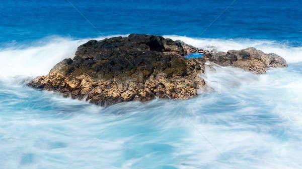 Longo tiro ondas lava rocha Foto stock © backyardproductions