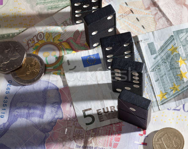 Standing dominoes on bank notes Stock photo © backyardproductions