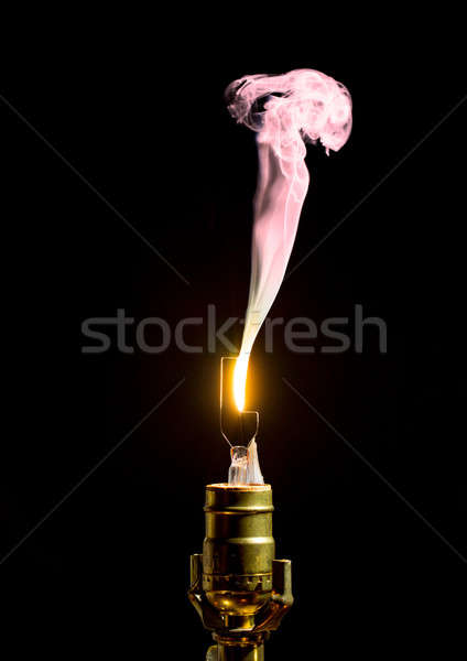 Broken lightbulb flares up in smoke Stock photo © backyardproductions