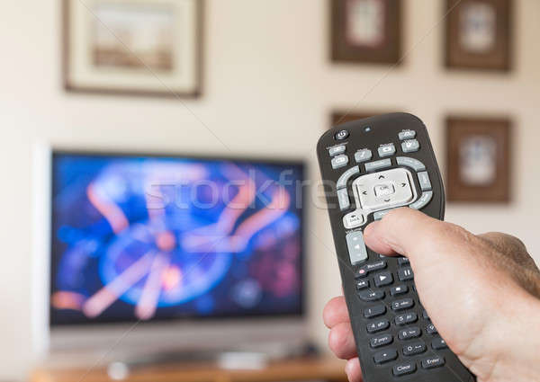 Close up of TV remote control with television Stock photo © backyardproductions