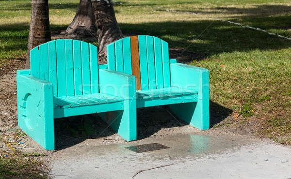 Green turquoise street bench in Miami beach Stock photo © backyardproductions