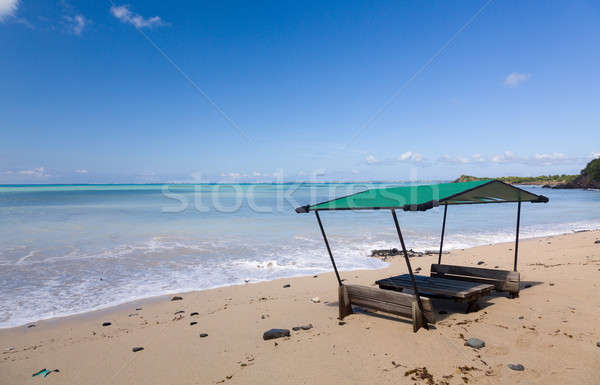 Table and chairs covered by sand on beach Stock photo © backyardproductions