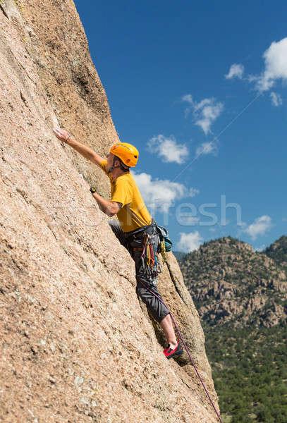 Senior man on steep rock climb in Colorado Stock photo © backyardproductions