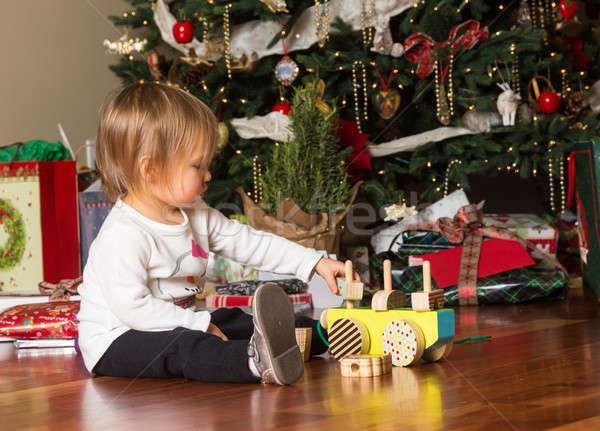 Young caucasian baby girl playing with presents at xmas Stock photo © backyardproductions