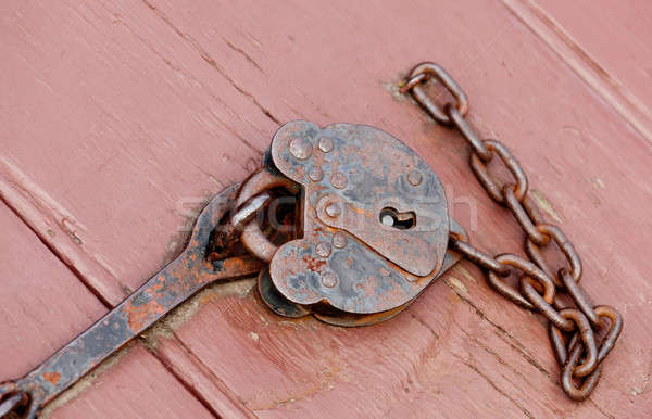 Antique lock and chain on wood Stock photo © backyardproductions