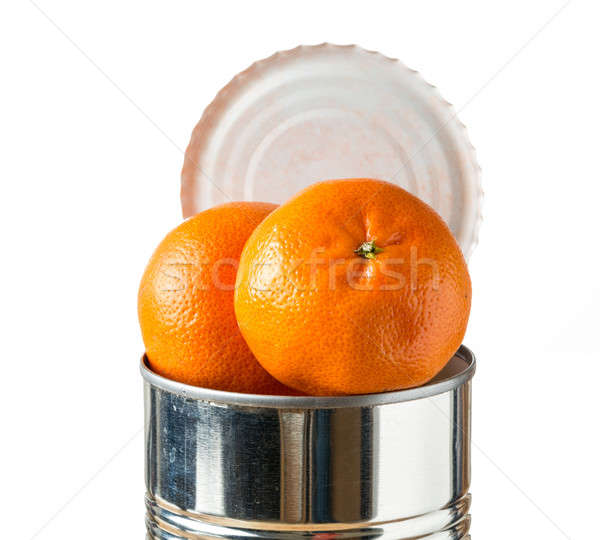 Oranges bursting out of tin can Stock photo © backyardproductions