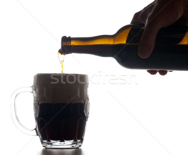 Beer poured into pint glass Stock photo © backyardproductions
