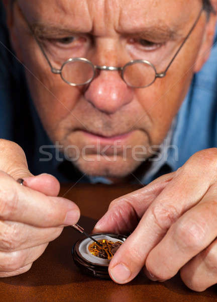 Senior craftsman repairing pocket watch Stock photo © backyardproductions