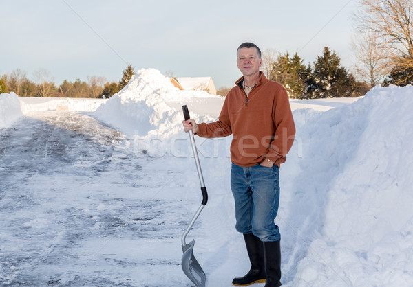 Senior adult man happy after digging out drive in snow Stock photo © backyardproductions