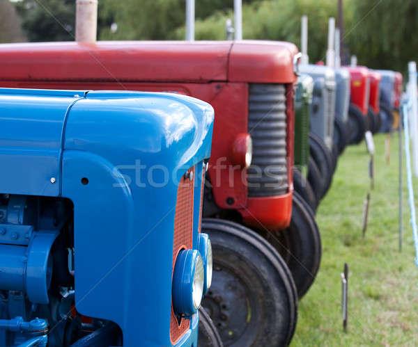 Row of old tractors Stock photo © backyardproductions