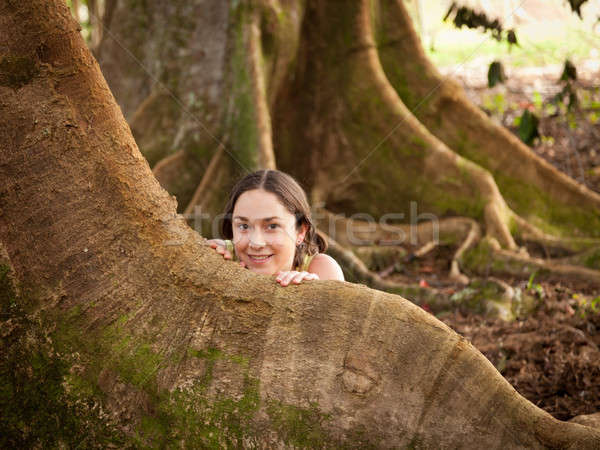 Girl peeping from behind Moreton Fig Stock photo © backyardproductions