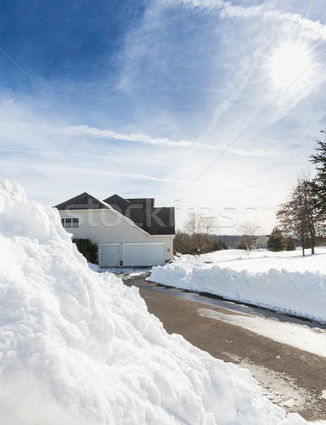 Deep drifts by side of driveway to modern home Stock photo © backyardproductions