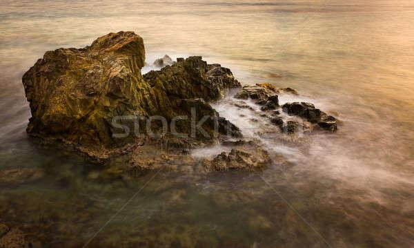 Long exposure sunset on sea rocks Stock photo © backyardproductions
