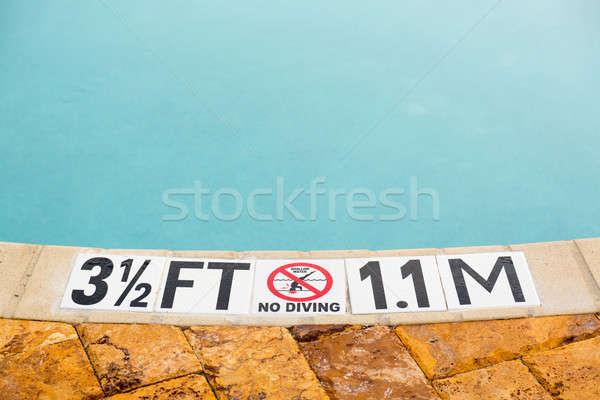 Stockfoto: Drie · half · voeten · zwembad · teken · tonen