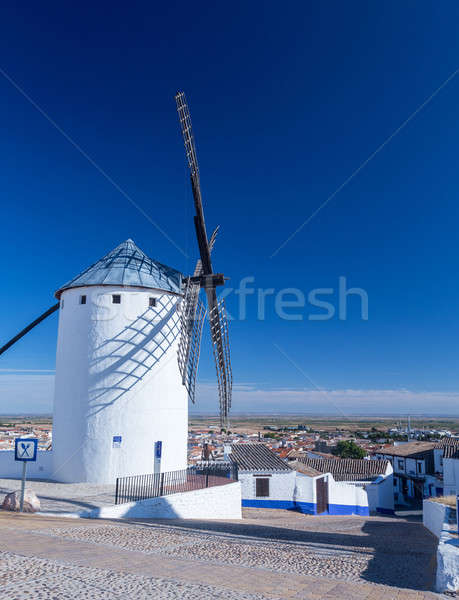 Windmill and town of Campo de Criptana La Mancha, Spain Stock photo © backyardproductions