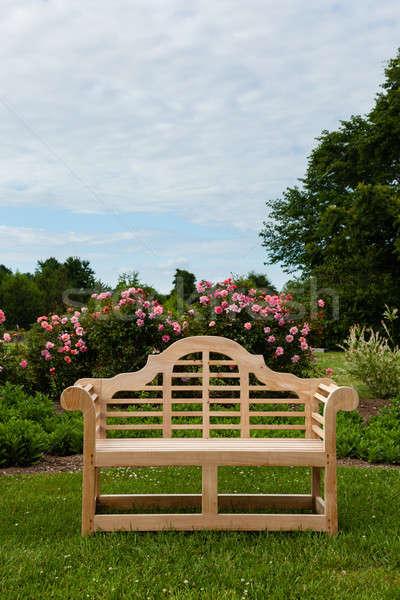 Teak bench or chair in garden setting Stock photo © backyardproductions