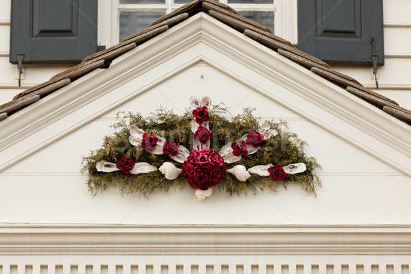 Traditional xmas wreath above front door Stock photo © backyardproductions