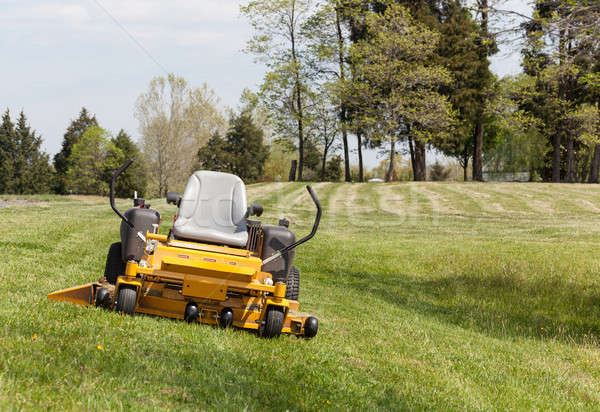Zero turn lawn mower on turf with no driver Stock photo © backyardproductions