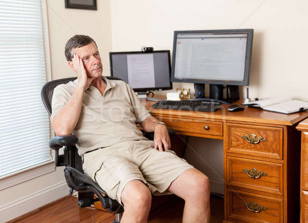 Senior male working in home office Stock photo © backyardproductions