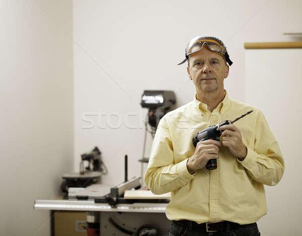 Senior man holding power drill Stock photo © backyardproductions