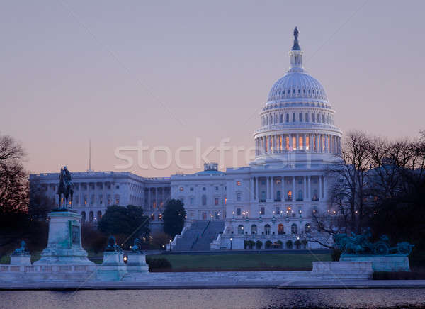 Sunrise behind the dome of the Capitol in DC Stock photo © backyardproductions