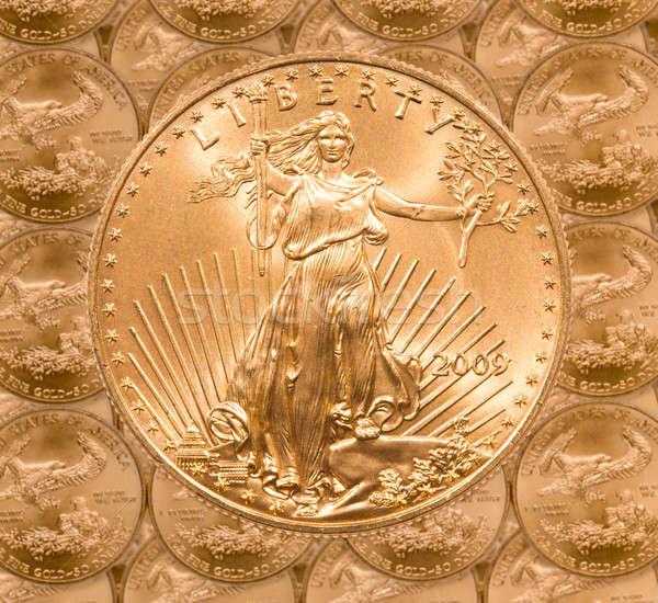 Single Liberty gold coin Stock photo © backyardproductions