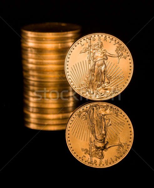 Reflection of one ounce gold coin black Stock photo © backyardproductions