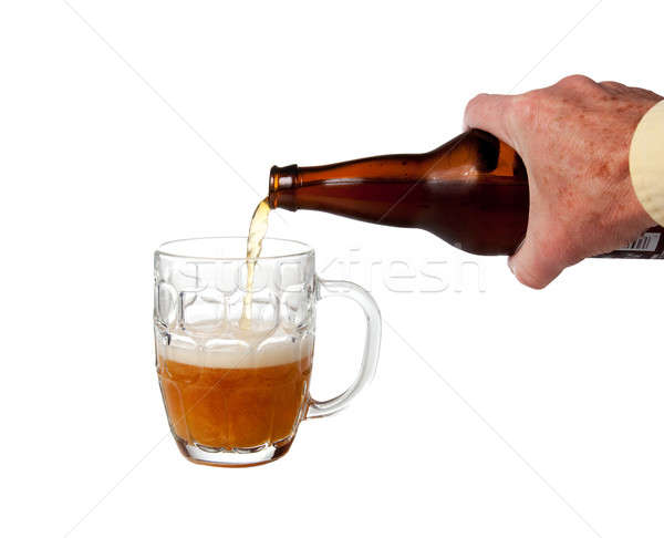 Beer being poured from bottle Stock photo © backyardproductions