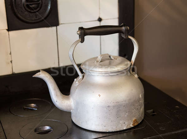 старомодный чайник металл сидят черный Сток-фото © backyardproductions