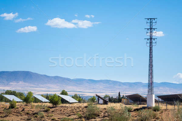 Stock photo: Solar panels in sun under mountains