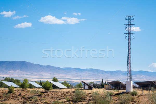 Painéis solares sol montanhas eletricidade poder Foto stock © backyardproductions