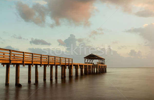 Longa exposição pier imagem pôr do sol oceano estrutura Foto stock © backyardproductions