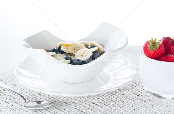 Breakfast of bran flakes blueberries Stock photo © backyardproductions