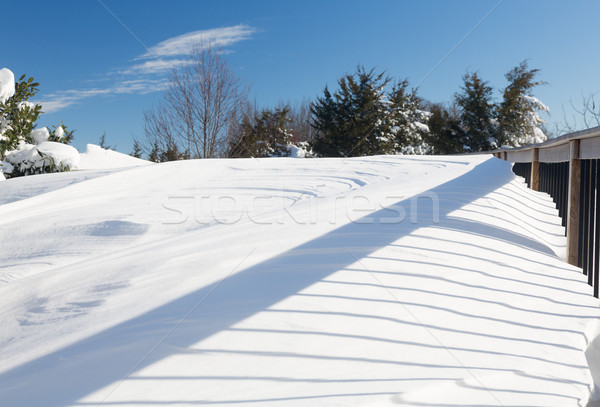 Deep snow in drifts on deck in back yard Stock photo © backyardproductions