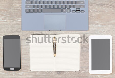 Overhead top view of wooden desk with computing gear Stock photo © backyardproductions