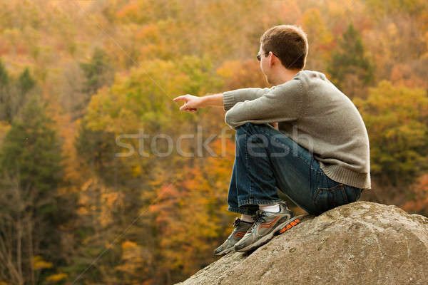 Young hiker relaxing on rock Stock photo © backyardproductions