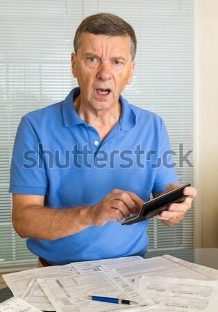 Senior man preparing USA tax form 1040 for 2012 Stock photo © backyardproductions