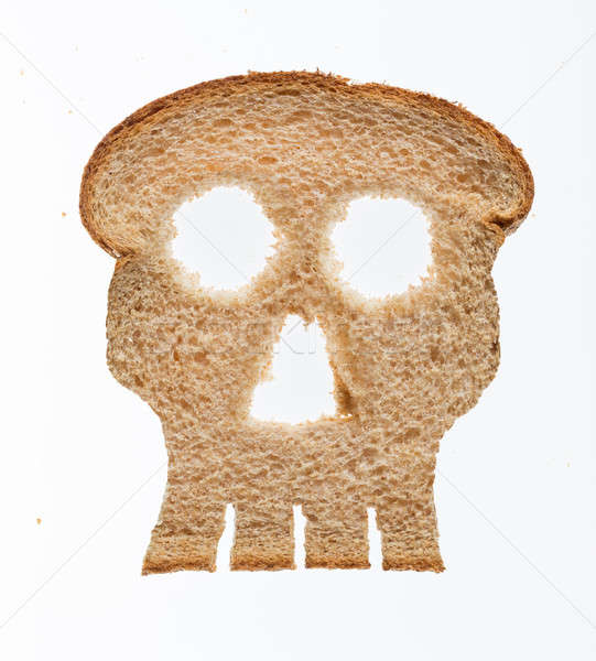 Slice of wholewheat bread in shape of skull Stock photo © backyardproductions