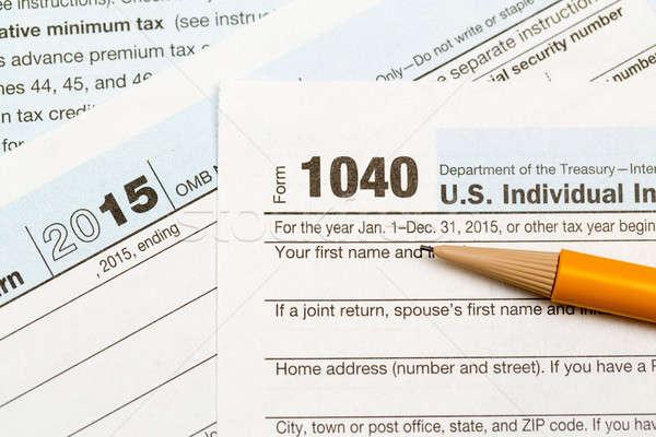 Pencil laying on 2015 IRS form 1040 Stock photo © backyardproductions