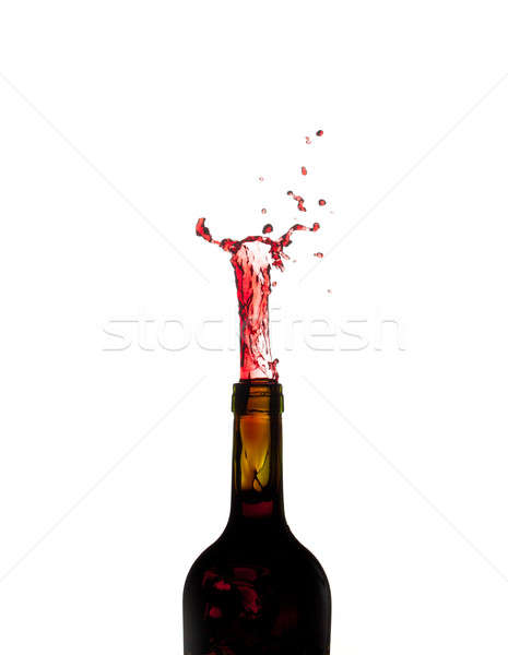 Red Wine shooting from green bottle Stock photo © backyardproductions