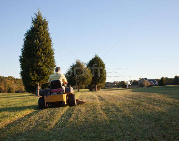 Senior mowing lawn Stock photo © backyardproductions