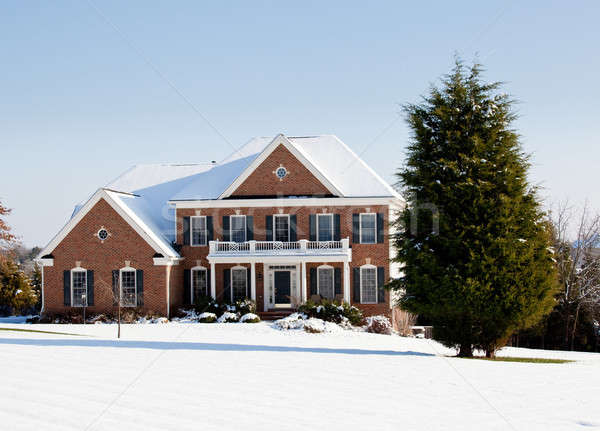 Modern single family home in snow Stock photo © backyardproductions