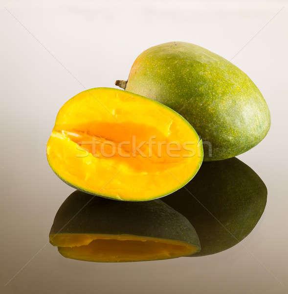 Two mangoes on reflecting surface Stock photo © backyardproductions