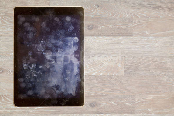 View of fingerprints and grease on tablet screen Stock photo © backyardproductions