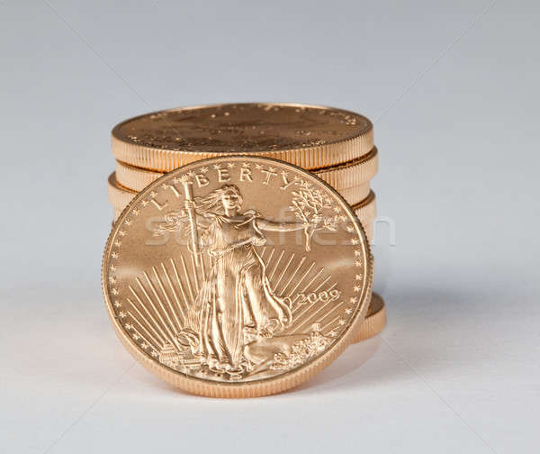 Stack of pure gold coins with Liberty facing Stock photo © backyardproductions