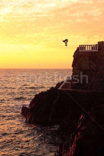 утес Diver побережье закат молодые Сток-фото © backyardproductions